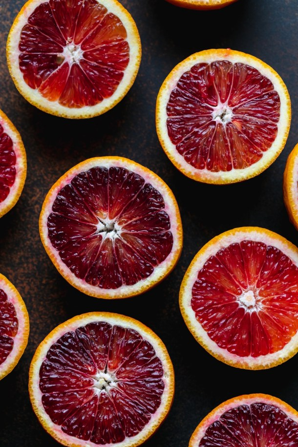 Overhead close up shot of halved blood oranges