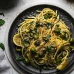 Overhead shot of pasta on a dark plate