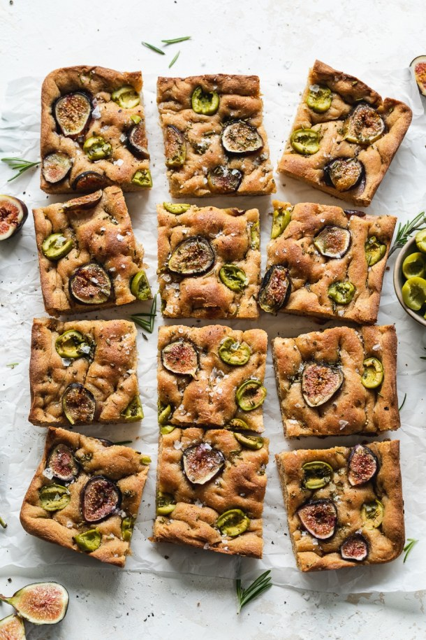 Overhead shot of pieces of whole wheat fig olive rosemary focaccia