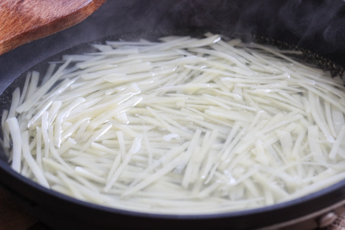 Blanch the shredded potatoes