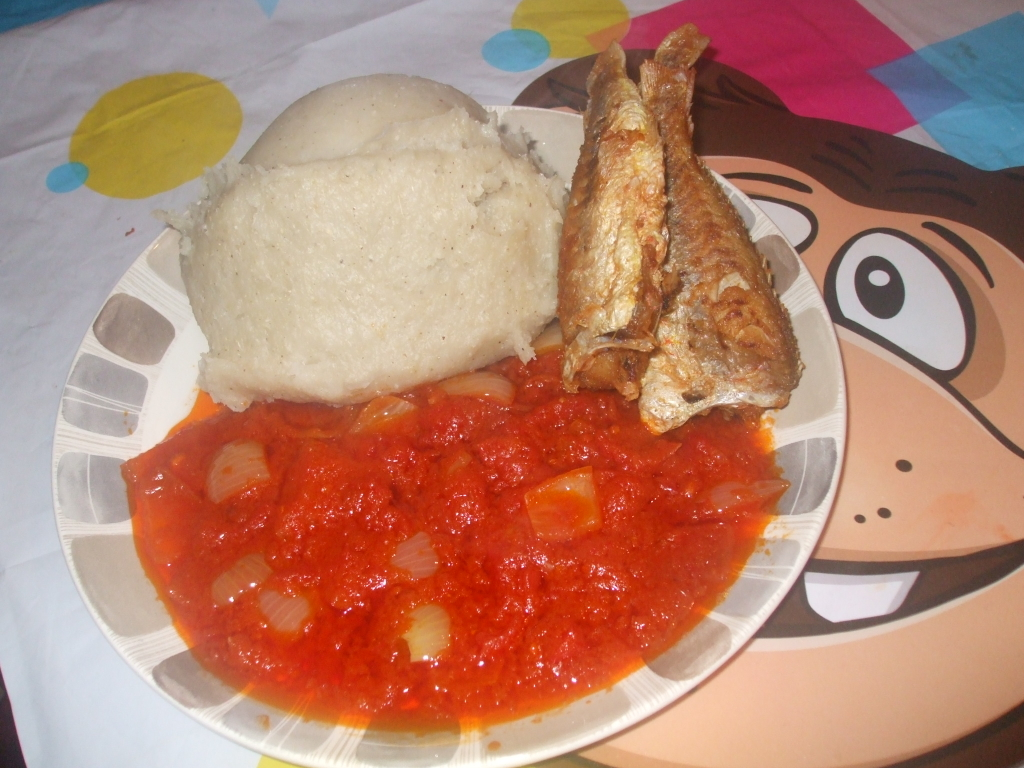 banku, fried red tilapia with spicy tomato gravy