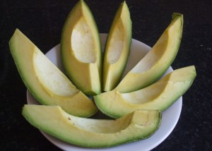 sliced riped avocado pear