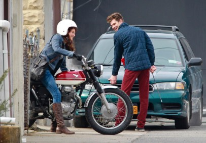 Andrew Garfield fixes a broken down car while chatting with a motorcycle riding Shailene Woodley as they continue to film 'The Amazing Spider-Man 2' in Brooklyn