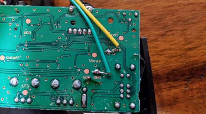 Just two connections need to be soldered on the back of the well-labelled Korg Monotron PCB: one to the gate pad and the other to the GND pad