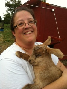 joy holding fawn the baby goat 2014 smiling