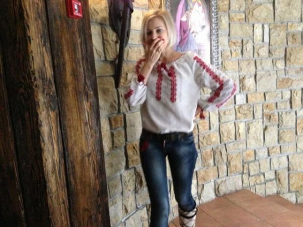 Natalia Poklonskaya in white shirt and jeans