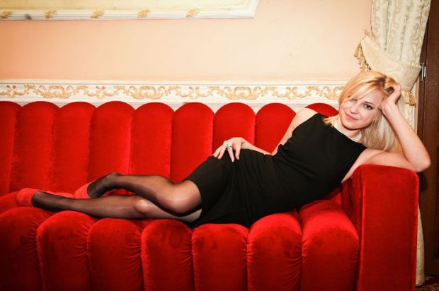 Sexy Natalia Poklonskaya Posing on Couch in Little Black Dress and Nylons