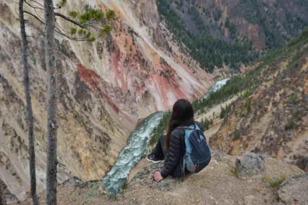 girl on edge of grand canyon of yellowstone