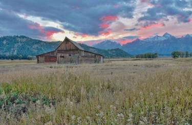 T.A. moulton barn at sunset with Tetons in background