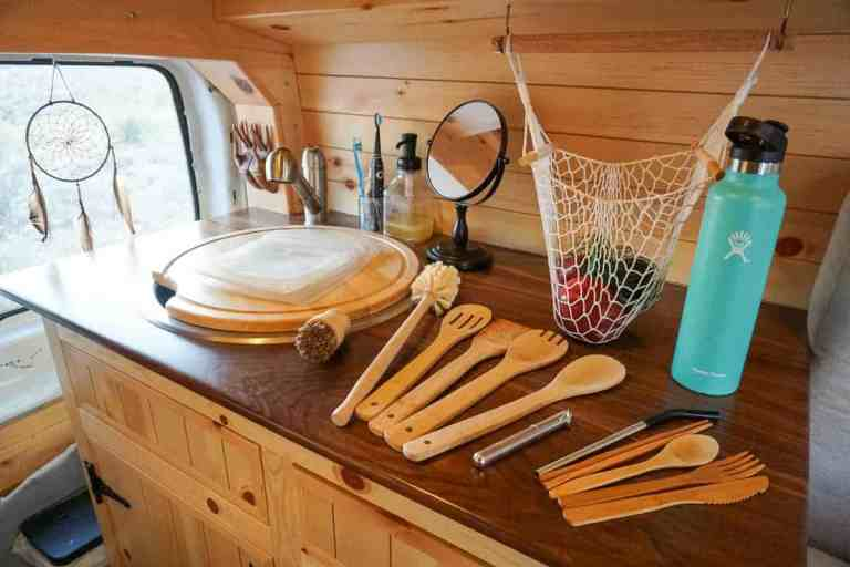 zero waste products for the kithcen bamboo cooking and eating utensils and reusable water bottle and straw