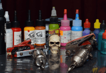 Tattoo machine, ink, and small skull, photo by diegoservelion