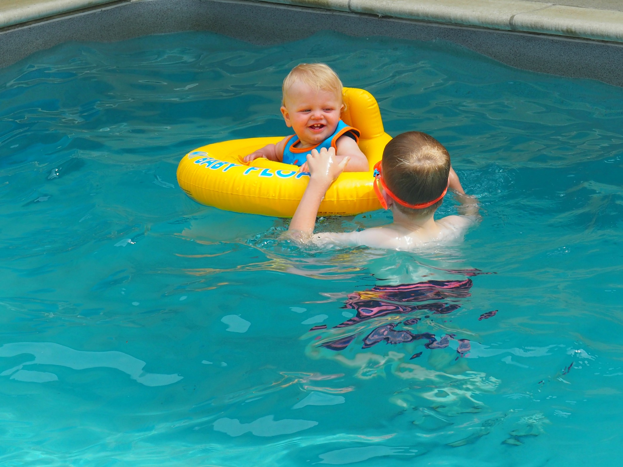 baby learning to swim