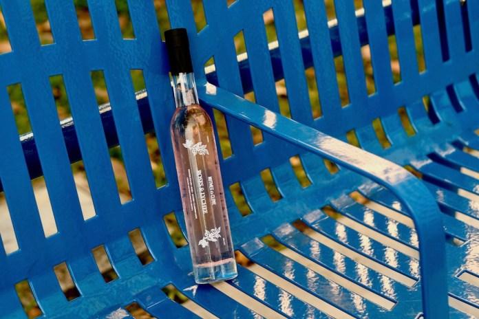 nutmeg & clove roses & lychee bottled cocktail