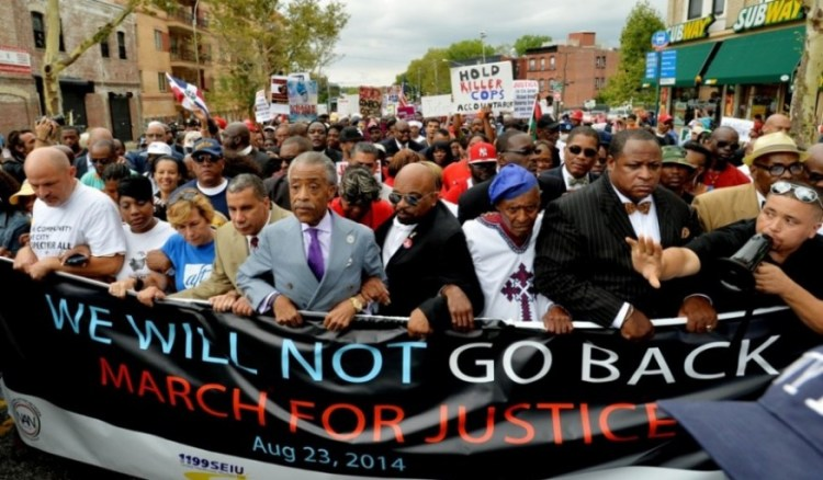 Rev. Al Sharpton (5-L) leading march in Staten Island, New York, USA, 23 August 2014, organized by Sharpton's 'National Action Network', to protest recent police shootings of black men in NYC and Ferguson, in which no indictments were handed down by grand juries.  [EPA/JUSTIN LANE]