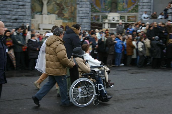 people in wheelchairs at Lourdes