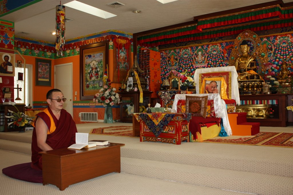 Shrine room at Kumbum Chamtse Ling Temple with spiritual teacher Geshe Kunga (Lori Erickson photo)