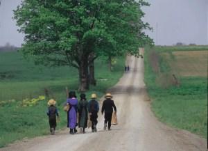 Amish family walking down road