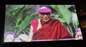 The Dalai Lama's address was projected on large video screens in Louisville. (Lori Erickson)