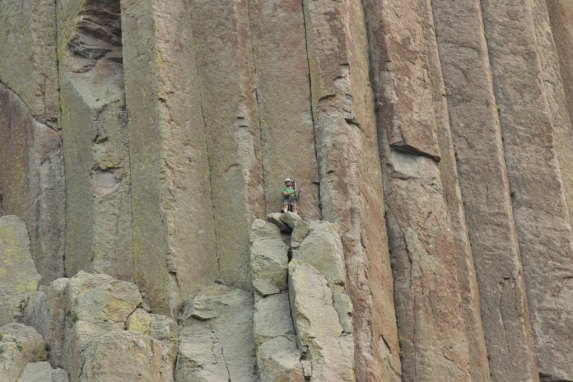 A climber ascends Devils Tower (Bob Sessions photo).