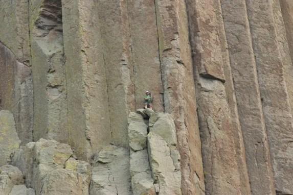 A climber ascends Devils Tower (Bob Sessions photo).
