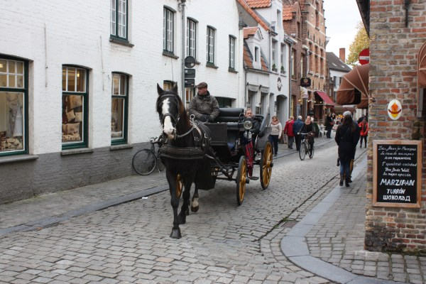 Carriages offer rides through the historic quarter of Bruges (Bob Sessions photo)