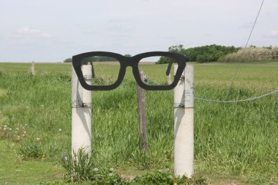 The path to the crash site is marked by a sculpture recalling Buddy Holly's iconic eyeglasses. (Bob Sessions photo)