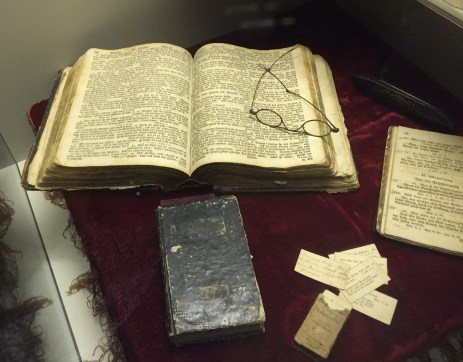 bible with pair of glasses