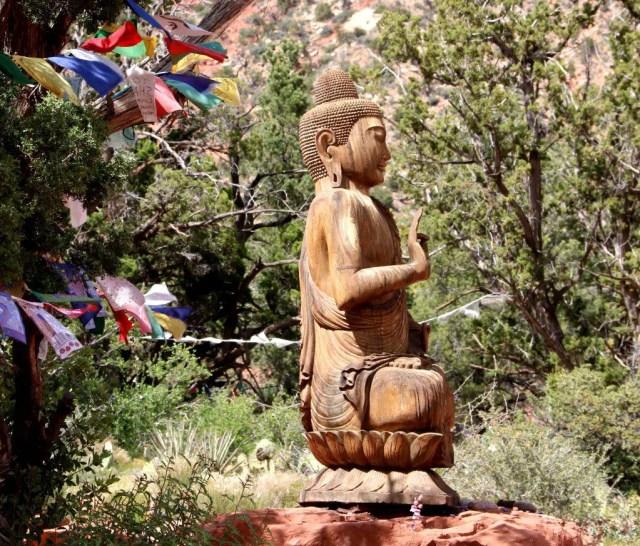A statue of the Buddha overlooks the Amitabha Stupa . (Bob Sessions photo)
