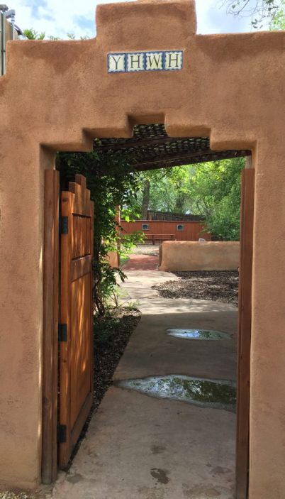 A doorway marked with YHWH, a Hebrew name for God, leads into the courtyard at the Center for Action and Contemplation. (Bob Sessions photo)