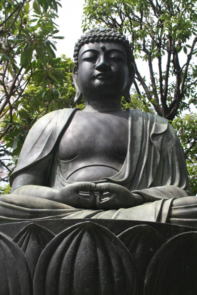 Buddha statue with trees in background