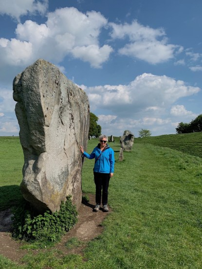 woman next to standing stone