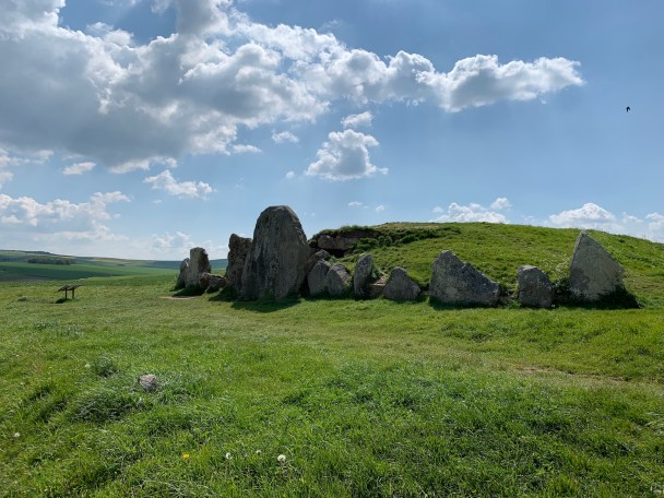 West Kennet Long Barrow with clouds overhead