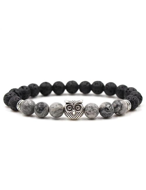 Boeddhistische lavasteen howliet uil armband zilver