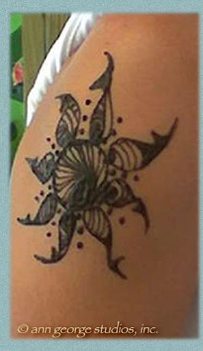 tribal sun henna tattoo
