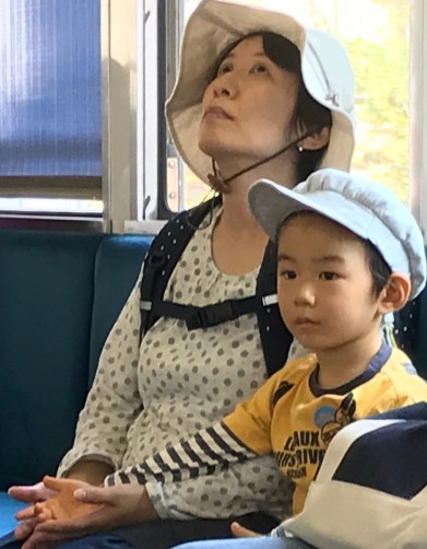 faces mom and son on train kyoto blog