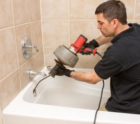 Plumber in Coto de Caza repairing clogged drain