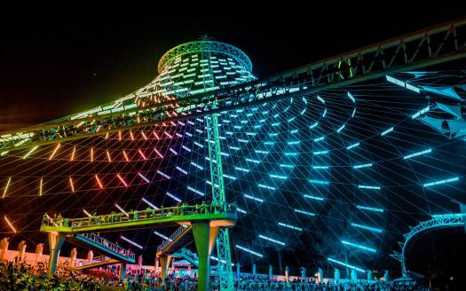 Upward view of U.S. Pavilion in Spokane's Riverfront Park, with rainbow-colored light show.