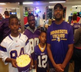 Local Vikings fans Maalik Harut (right) with (l-r) son Maalik, Jr., family friend Alphonso Gbalea, and son Maciah