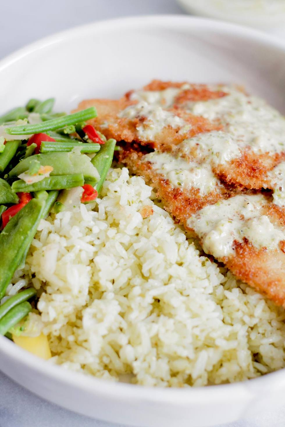 Fish with creamy garlic pesto rice bowl spoonful of butter for Garlic sauce for fish