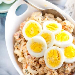Quick and easy Homestyle Macaroni Salad - a perfect side dish for your summer barbeque. The combination of eggs, carrots, onions, relish, pineapple, and shredded chicken makes this salad extra tasty!