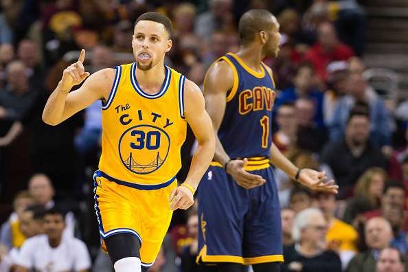 CLEVELAND, OH - JANUARY 18: Stephen Curry #30 of the Golden State Warriors celebrates after scoring over James Jones #1 of the Cleveland Cavaliers during the second half at Quicken Loans Arena on January 18, 2016 in Cleveland, Ohio. The Warriors defeated the Cavaliers 132-98. NOTE TO USER: User expressly acknowledges and agrees that, by downloading and/or using this photograph, user is consenting to the terms and conditions of the Getty Images License Agreement. Mandatory copyright notice. (Photo by Jason Miller/Getty Images)