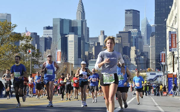 Runners make their way down 44th Drive in the Queens borough of New York during the New York City Marathon on Sunday, Nov. 6, 2011, in New York. (AP Photo/Kathy Kmonicek)