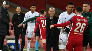 Smiling Zinedine Zidane spotted by Real Madrid fans during the clash between Casemiro and Andy Robertson