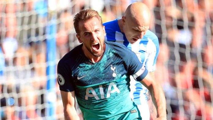 Harry Kane celebrates putting spurs ahead at Huddersfield Town