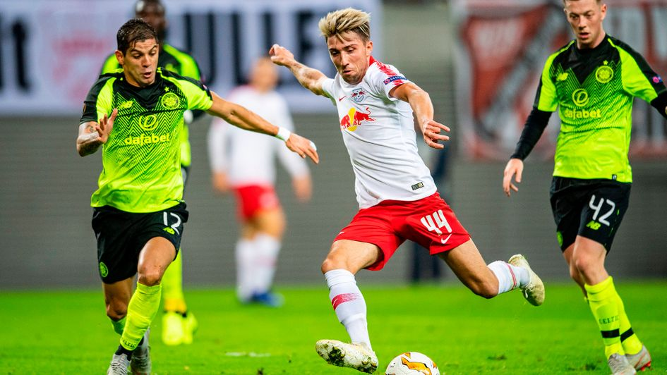 Kevin Kampl (R) and Cristian Gamboa compete for the ball