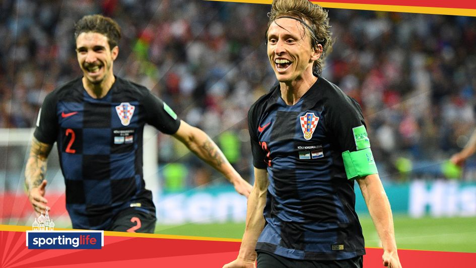 Luka Modric celebrates after scoring for Croatia