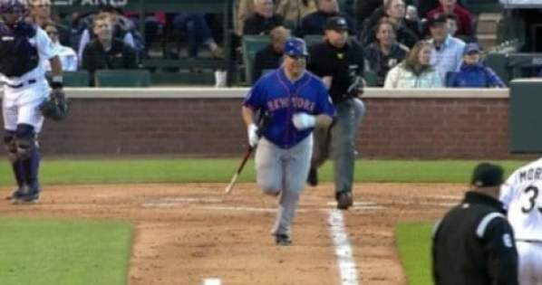bartolo-colon-carries-bat