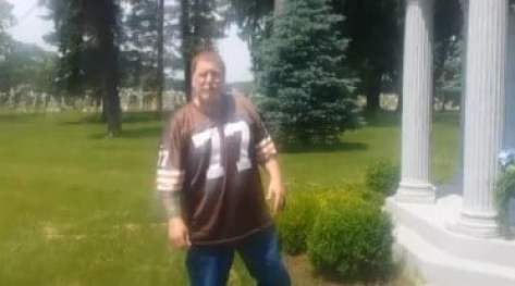 browns-fan-pees-on-grave