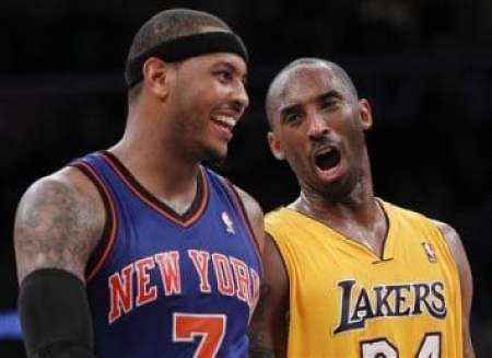Lakers' Kobe Bryant talks with Knicks' Carmelo Anthony as the Lakers lead the Knicks during second half of their NBA basketball game in Los Angeles