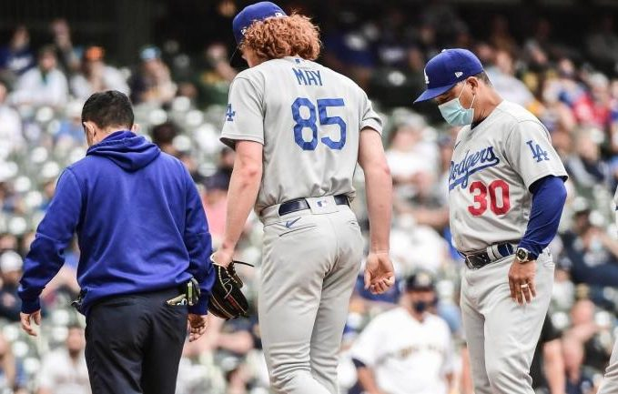 Dustin May leaves game and season